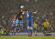 Sheffield Wednesday striker Gary Hooper (14) and Brighton central defender, Lewis Dunk (5) challenge for a header during the Sky Bet Championship match between Brighton and Hove Albion and Sheffield Wednesday at the American Express Community Stadium, Brighton and Hove, England on 8 March 2016. Photo by Adam Rivers.