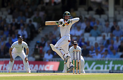 Pakistan's Yasir Shah fens off a bouncer from England's Chris Woakes