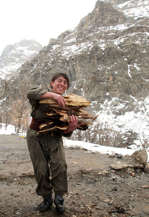 21 Feb 2004....Qandil Mountains, Kurdistan/Iraq.....PKK Camp...The PKK reached a peak of notoriety during the decade from mid 80s-mid 90's. During this period they were involved a series of high profile bomb attacks and kidnappings.....The Leader and President of the PKK, Abdullah Ocalan is currently imprisoned on a small island off the Turkish mainland.....His followers believe that he can lead the Kurds to freedom and independence. In the light of this it is unlikely that the Turkish Government will ever allow him to be released.....The PKK winter camps are high in the snow covered Qandil mountains. The mountain range falls within what is international recognised as Iraq. The Kurds call the area Southern Kurdistan.....Most of the PKK fighters living in the camps are from Turkey. Many of them have lived in the mountains for more than half their lives.....The Turkish Government did offer a programe of repatriation to the PKK but few of the fighters felt it avantageous...They chose instead to remain living in the harsh mountian enviroment prepared to fight for their people.....The PKK is at this time in what they describe as a 'Position of Legitimate Defense'. They claim not to be involved in any military action but will defend them selves if attacked...