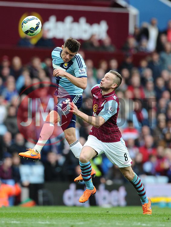 West Ham United's Aaron Cresswell heads the ball home under pressure from Aston Villa's Tom Cleverley  - Photo mandatory by-line: Joe Meredith/JMP - Mobile: 07966 386802 - 09/05/2015 - SPORT - Football - Birmingham - Villa Park - Aston Villa v West Ham United - Barclays Premier League