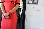 stewardess Portuguese Airline Lines  in the aisle inside a airplane
