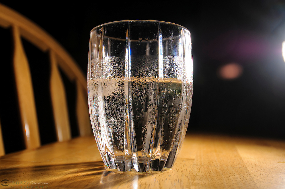 Clear beverage on a table.