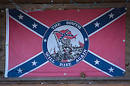Fishing camp with confederate flag on the the Pearl River in St. Tammany Parish, Louisiana.trees.