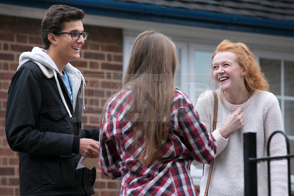 © Licensed to London News Pictures. 14/08/2014. Solihull, West Midlands, UK. A level results announced at Solihull School earlier today. George Diwaker, Lauren Buchan and Maddie Lavery, all 18, discuss their results. Photo credit : Dave Warren/LNP