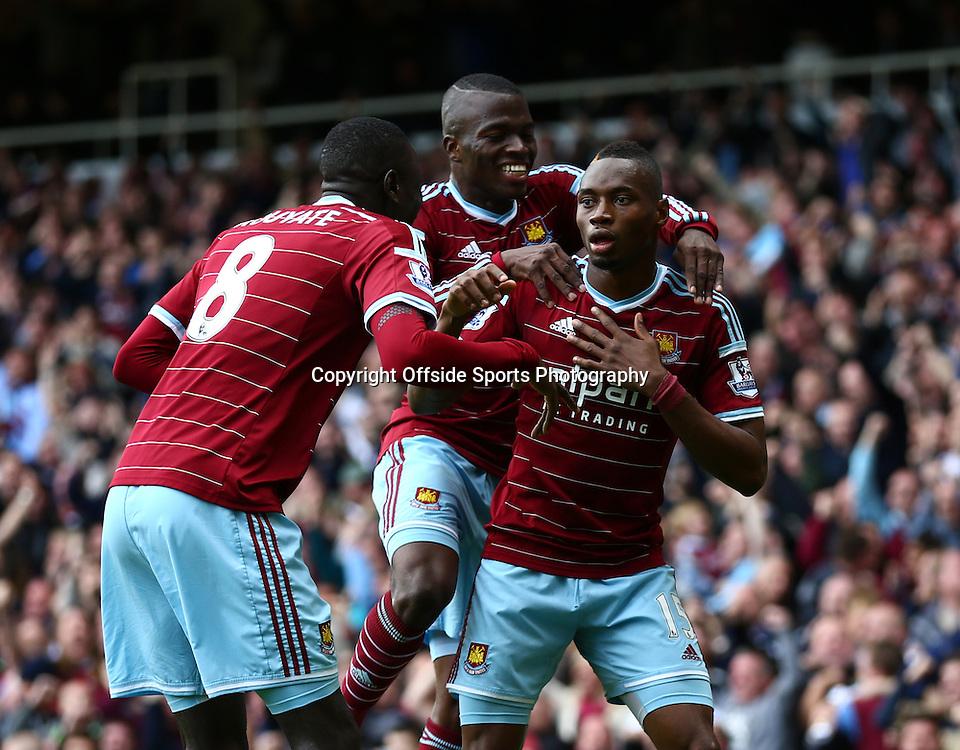 25 October 2014 - Barclays Premier League - West Ham v Manchester City - Diafra Sakho of West Ham celebrates scoring the 2nd goal with team mates - Photo: Marc Atkins / Offside.