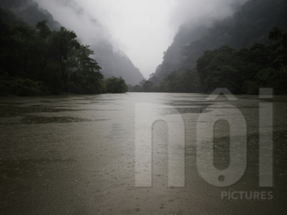 Water drops on a river flowing through a jungle. Ba Be lake, Vietnam, Asia