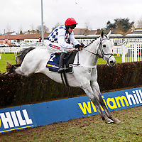 Simonsig - Barry Geraghty wins.The williamhill.com Novices' Chase.Kempton Park 27/12/12..©cranhamphoto.com