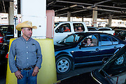 A man from Mexico does the long wait for the Seattle to Bainbridge Island ferry on a hot Friday afternoon in summer.
