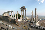 Temple of Trajan or Trajaneum, built 2nd century AD, Pergamon, modern-day Bergama, Izmir, Turkey. This Roman temple was built 117-138 AD by Hadrian, Trajan's successor, and both Emperors were worshipped here as they were thought to be divine. It was built on the site of a previous Hellenistic building. It is Corinthian in style and consists of a plan of 6x9 marble columns over a plot of 68x58m, surrounded on 3 sides by covered promenades. The Trajaneum occupies the highest level of the acropolis of Pergamon. Picture by Manuel Cohen