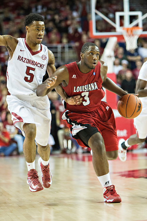 FAYETTEVILLE, AR - NOVEMBER 15:  Xavian Rimmer #3 of the Louisiana Ragin' Cajuns dribbles the ball down the court during a  game against the Arkansas Razorbacks at Bud Walton Arena on November 15, 2013 in Fayetteville, Arkansas.  The Razorbacks defeated the Ragin' Cajuns 76-63.  (Photo by Wesley Hitt/Getty Images) *** Local Caption *** Xavian Rimmer