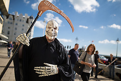 © Licensed to London News Pictures . 27/09/2015 . Brighton , UK . Defend the NHS protester dressed as Death outside the 2015 Labour Party Conference . Photo credit : Joel Goodman/LNP