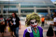 Michaell Cherry shows his Joker costume during Comic Con, Friday, July 19, 2013 in San Diego, California.  Comic Con International Convention is the Worlds largest Comic and entertainment event and hosts celebrity movie panels, a trade floor with comic book, Science Fiction and action film related booths, as well as artist workshops,  movie premieres and much more.(Photo by Sandy Huffaker/Getty Images)