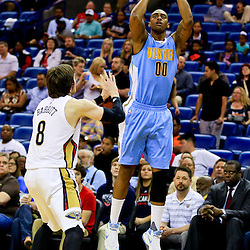 Mar 31, 2016; New Orleans, LA, USA; Denver Nuggets forward Darrell Arthur (00) shoots over New Orleans Pelicans forward Luke Babbitt (8) during the first quarter of a game at the Smoothie King Center. Mandatory Credit: Derick E. Hingle-USA TODAY Sports