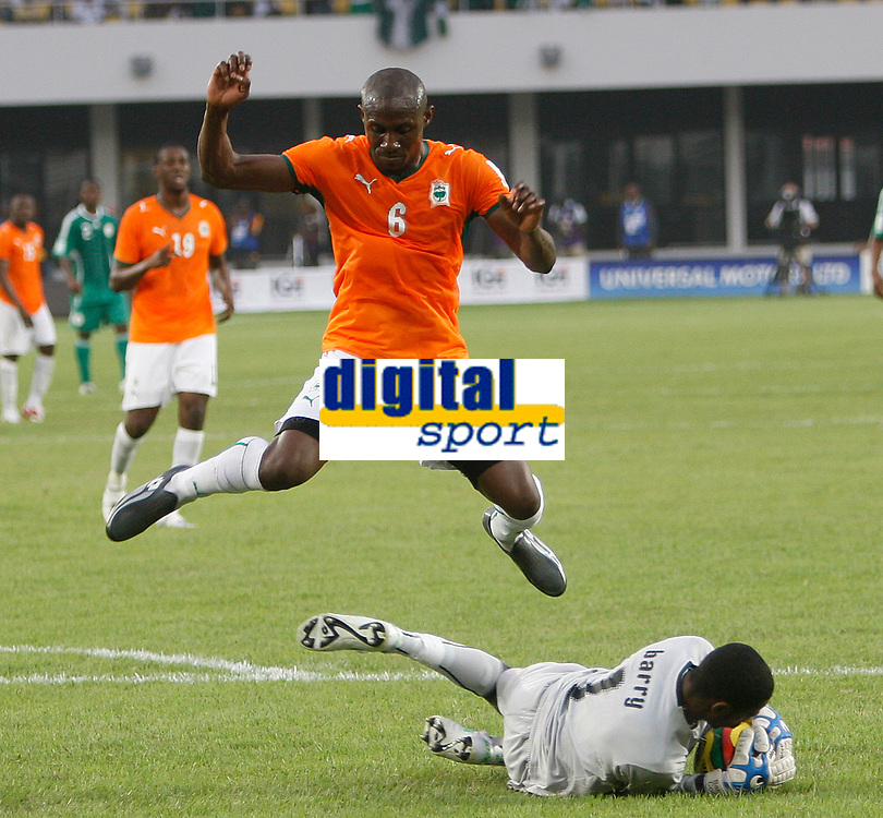Photo: Steve Bond/Richard Lane Photography.<br />Nigeria v Ivory Coast. Africa Cup of Nations. 21/01/2008. Keeper Boubacar Barry gathers and is vaulted by his defender Lohore Gohouri