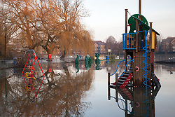 © Licensed to London News Pictures. 12/01/2014. Reading, Berkshire, UK. A children's playground flooded along the Thames Path in Reading, Berkshire. The River Thames has broken its banks causing extensive flooding. Photo credit : Rob Arnold/LNP