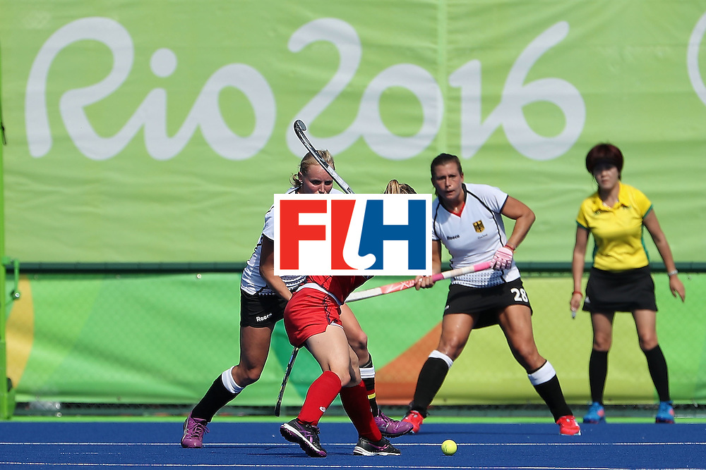 RIO DE JANEIRO, BRAZIL - AUGUST 15:  Julia Reinprecht #12 of United States attempts a shot against Germany during the quarter final hockey game on Day 10 of the Rio 2016 Olympic Games at the Olympic Hockey Centre on August 15, 2016 in Rio de Janeiro, Brazil.  (Photo by Christian Petersen/Getty Images)