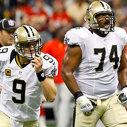 September 23, 2012; New Orleans, LA, USA; New Orleans Saints quarterback Drew Brees (9) and offensive tackle Jermon Bushrod (74) react after a touchdown to wide receiver Lance Moore (not pictured) during the first quarter of a game against the Kansas City Chiefs at the Mercedes-Benz Superdome. Mandatory Credit: Derick E. Hingle-US PRESSWIRE