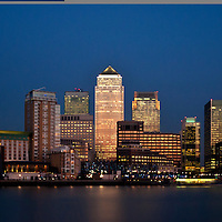 Panoramic night view of the buildings of the illuminated financial district Canary Wharf in London
