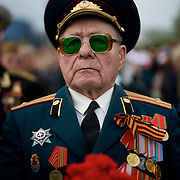 A veteran of the Second World War, attends a ceremony that marks 69 years since the Soviets defeated the Nazis, at the War Memorial in central Donetsk, amid tensions over the referendum for autonomy of the region to be held over the weekend.