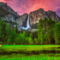 Pink light after sunset above Yosemite Falls in spring, Yosemite National Park California.