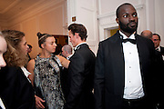 FRANCESCA CICIC; SARAH POFFA; CHARLES HUNT; ASHLEY PLUMMER-CAMBRIDGE, Tuxedo: The Little Black Jacket project Ð a collaboration between London College of Fashion and Henry Poole and Co, Quintessentially . 29 Portland Place, London. 7 September 2011. <br /> <br />  , -DO NOT ARCHIVE-© Copyright Photograph by Dafydd Jones. 248 Clapham Rd. London SW9 0PZ. Tel 0207 820 0771. www.dafjones.com.<br /> FRANCESCA CICIC; SARAH POFFA; CHARLES HUNT; ASHLEY PLUMMER-CAMBRIDGE, Tuxedo: The Little Black Jacket project – a collaboration between London College of Fashion and Henry Poole and Co, Quintessentially . 29 Portland Place, London. 7 September 2011. <br /> <br />  , -DO NOT ARCHIVE-© Copyright Photograph by Dafydd Jones. 248 Clapham Rd. London SW9 0PZ. Tel 0207 820 0771. www.dafjones.com.