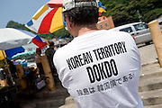 Sung Kyu-lim shows off a T-shirt stating Korea's sovereignty over the disputed Dokdo Islands on neighboring Ulleungdo Island in South Korea on on 22 June 2010..Photographer: Robert Gilhooly