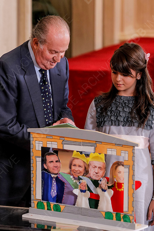 15.OCTOBER.2012. MADRID<br /> <br /> KING JUAN CARLOS MEETS WINNERS OF THE 'WHAT IS A KING FOR YOU?' COMPETITION FOR CHILD AT ZARZUELA PALACE IN MADRID. <br /> <br /> BYLINE: EDBIMAGEARCHIVE.CO.UK<br /> <br /> *THIS IMAGE IS STRICTLY FOR UK NEWSPAPERS AND MAGAZINES ONLY*<br /> *FOR WORLD WIDE SALES AND WEB USE PLEASE CONTACT EDBIMAGEARCHIVE - 0208 954 5968*