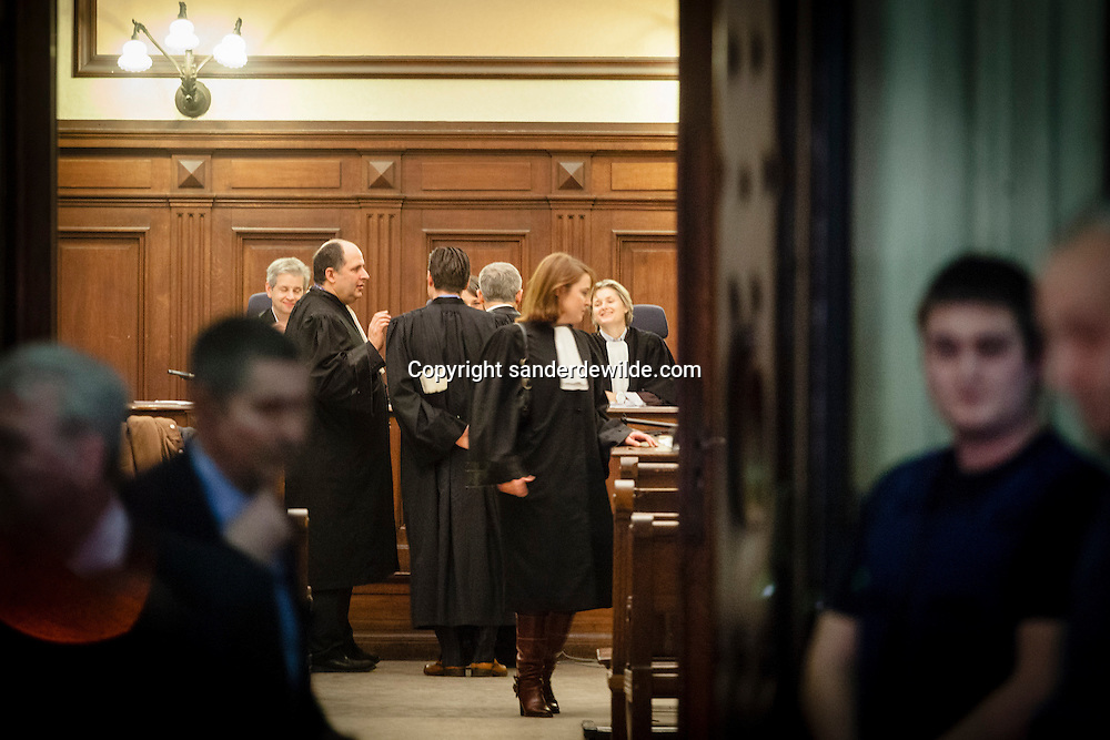 Brussels, Belgium 4th February 2013. Belgium's most notorious criminal Dutroux has asked a court to grant him early release from prison. .The lawyer of Dutroux, Pierre Deutsch (left, bold) talks to other lawyers before the trial. Marc Dutroux was convicted of abducting, imprisoning and raping six young girls in 2004.
