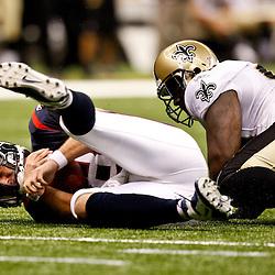 August 21, 2010; New Orleans, LA, USA; New Orleans Saints defensive tackle Sedrick Ellis (98) sacks Houston Texans quarterback Matt Schaub (8) during the first quarter of a preseason game at the Louisiana Superdome. Mandatory Credit: Derick E. Hingle