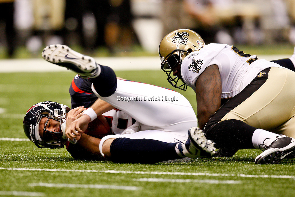 August 21, 2010; New Orleans, LA, USA; New Orleans Saints defensive tackle Sedrick Ellis (98) sacks Houston Texans quarterback Matt Schaub (8) during the first quarter of a preseason game at the Louisiana Superdome. Mandatory Credit: Derick E. Hingle