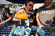 """Bandit's Gilbert Altshul adds N'duja cheese sauce to their """"walking taco"""" during the 4th annual Yum Yum Fest held at Breese Stevens Field, Sunday, August 6, 2017."""