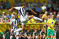 Picture by Paul Chesterton/Focus Images Ltd.  07904 640267.11/9/11.Gabriel Tamas of West Brom clears the ball during the Barclays Premier League match at Carrow Road stadium, Norwich.