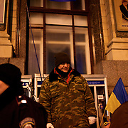 December 18, 2013 - Kiev, Ukraine: A pro-EU demonstrator guards an access to the Independence Square.<br /> On the night of 21 November 2013, a wave of demonstrations and civil unrest began in Ukraine, when spontaneous protests erupted in the capital of Kiev as a response to the government's suspension of the preparations for signing an association and free trade agreement with the European Union. Anti-government protesters occupied Independence Square, also known as Maidan, demanding the resignation of President Viktor Yanukovych and accusing him of refusing the planned trade and political pact with the EU in favor of closer ties with Russia.<br /> After a days of demonstrations, an increasing number of people joined the protests. As a responses to a police crackdown on November 30, half a million people took the square. The protests are ongoing despite a heavy police presence in the city, regular sub-zero temperatures, and snow. (Paulo Nunes dos Santos/Polaris)