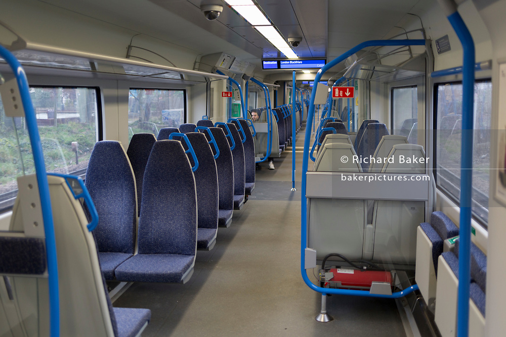 As the Coronavirus pandemic spreads across the UK, businesses and entertainment venues not already closed with the threat of job losses, struggle to stay open with growing rumours of a lockdown and travel restrictions around the capital. Londoners start to work from home lead to empty train carriage seats, on 19th March 2020, in London, England.