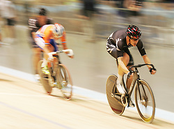 (Melbourne, Australia---08 April 2012) A New Zealand rider powers along the track during the Madison at the 2012 UCI Track Cycling World Championships.Copyright 2012 Sean Burges / Mundo Sport Images.