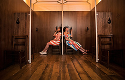 © Licensed to London News Pictures. 20/06/2017. London, UK. As visitors sit in a confessional they smell Avignon perfume by Comme Des Garcons at the 'Perfume: A Sensory Journey through Contemporary Scent' exhibition at Somerset House in London. In association with Coty, Peroni Ambra, Givaudan and Liberty London, the show opens on June 20, 2017 and runs until September 17, 2017. The exhibition explores the evolution of today's scent scene, by showcasing the work of ten perfume pioneers from the past two decades. Each perfume is experienced through a multisensory installation, which is designed in reference to the inspiration behind the scent itself. In addition, it features a working perfume laboratory stocked with over 200 ingredients. Visitors will be able to interact with and get instruction from professionals, seeing up close the skill and science of the perfumer. Photo credit: Peter Macdiarmid/LNP