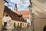 Rural architecture of a house and surrounding buildings in a back-street, on 26th June 2018, in Kamnik, Slovenia.