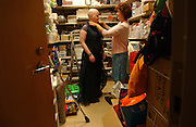Eileen Brazil and her mother Sheila get ready in a closet at the Pediatrics Prom at Memorial Sloan-Kettering Cancer Center in Manhattan, NY. 6/7/2005 Photo by Jennifer S. Altman