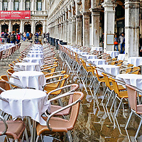 Tables are empty and waiting for customers after a flood at Piazza San Marco in Venice, Italy