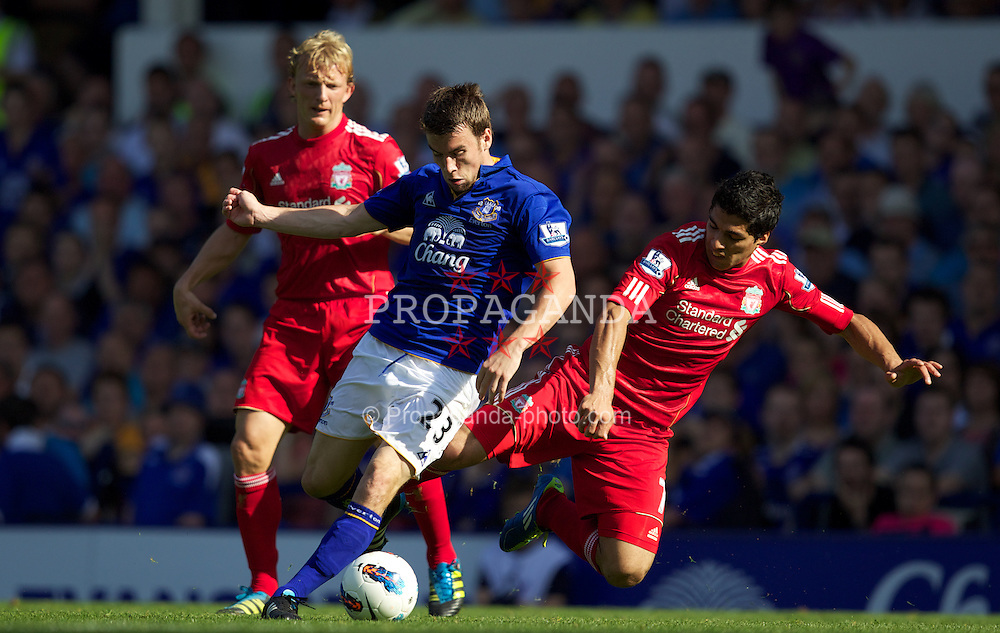 LIVERPOOL, ENGLAND - Saturday, October 1, 2011: Liverpool's Luis Alberto Suarez Diaz in action against Everton's Seamus Coleman during the Premiership match at Goodison Park. (Pic by Vegard Grott/Propaganda)