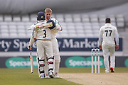 Yorkshire Batsman Joe Root celebrates his 200 Double Century with Yorkshire All-rounder Adil Rashid during the Specsavers County Champ Div 1 match between Yorkshire County Cricket Club and Surrey County Cricket Club at Headingley Stadium, Headingley, United Kingdom on 10 May 2016. Photo by Simon Davies.