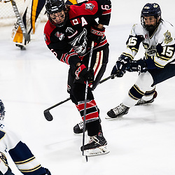 TORONTO, ON - APR 10, 2018: Ontario Junior Hockey League, South West Conference Championship Series. Game seven of the best of seven series between the Georgetown Raiders and the Toronto Patriots, Jacob Payette #6 of the Georgetown Raiders clears the puck during the first period.<br /> (Photo by Kevin Raposo / OJHL Images)