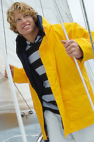 Young man standing on yacht