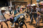 """Holy Week, the donkey utilised by the centurions, the main traditional authorities of the Holy Week, is beated with violence in a symbolic revenge against the """"Devils forces"""" that for days controlled the village. The """"Judios"""" paints their bodies simbolysing  the Evil forces and struggles in the streets looking for Jesus. Coras are a small indigenous people living scattered in the mountains of Sierra Madre Central in Mexican state of Nayarit. The Coras still follows their traditions, protecting in a very strong way their secret rites, that anthropologists believe the most interesting of Central America for their synchretism. The Holy Week, the most important religious event of the year, is characterized with impressive ceremonies. The catholic priest doesn't partecipate and the Black Centurion is the captain of Judea, the ?Jews?, the devil's militia looking for Jesus Christ to kill him. Violence is a essential part of the ceremonies and somebody can be killed in the struggles with wood swords. Today Coras are asking for help from Mexican authorities because the survival of the Holy Week is in danger for dramatic changes in Cora traditional society due to the emigration and drug wars."""