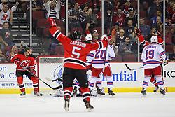 Sep 16, 2013; Newark, NJ, USA; New Jersey Devils left wing Mattias Tedenby (9) celebrates his goal on New York Rangers goalie Henrik Lundqvist (30) during the first period at Prudential Center.