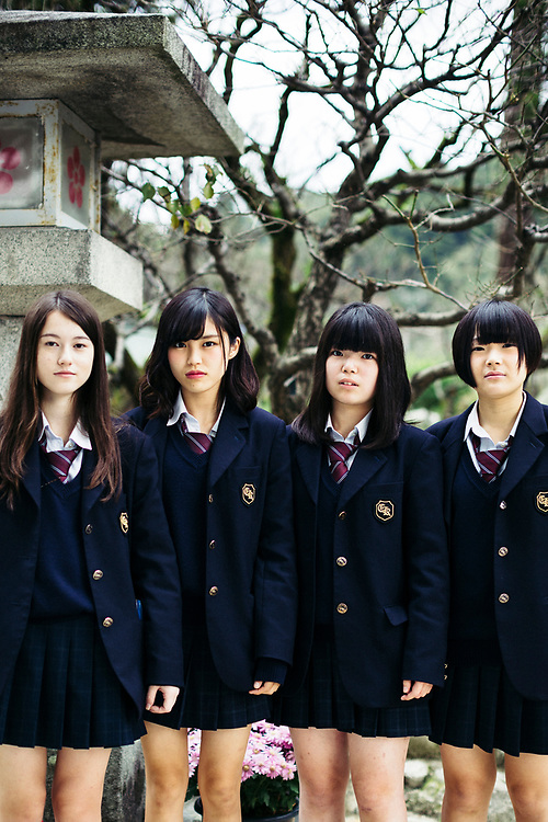 Young rebellious schoolgirls in short skirts at Dazaifu Shrine in Kyushu, Japan.