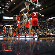 HARTFORD, CONNECTICUT- DECEMBER 19: Gabby Williams #15 of the Connecticut Huskies challenges for a rebound with Alexa Hart #22 of the Ohio State Buckeyes, Sierra Calhoun #4 of the Ohio State Buckeyes and Kia Nurse #11 of the Connecticut Huskies during the UConn Huskies Vs Ohio State Buckeyes, NCAA Women's Basketball game on December 19th, 2016 at the XL Center, Hartford, Connecticut (Photo by Tim Clayton/Corbis via Getty Images)