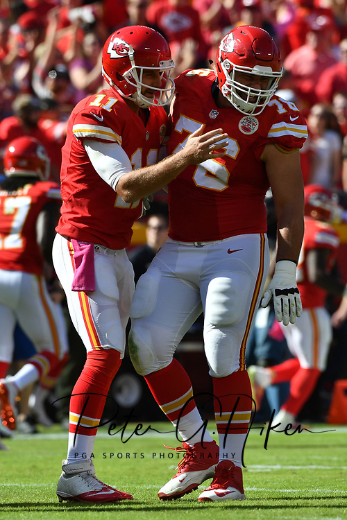 KANSAS CITY, MO - OCTOBER 23: Quarterback Alex Smith #11 of the Kansas City Chiefs celebrates a touchdown pass with Laurent Duvernay-Tardif #76 at Arrowhead Stadium during the second quarter of the game against the New Orleans Saints on October 23, 2016 in Kansas City, Missouri. (Photo by Peter Aiken/Getty Images)