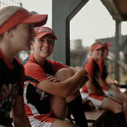 Catcher, Lee Ann Spivey, center, shares stories with her teammates prior to the game.<br /> <br /> Todd Spoth for The New York Times.