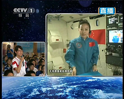 59870558  <br /> This TV grab taken on June 20, 2013 shows female astronaut Wang Yaping (R), one of the three crew members of Shenzhou-10 spacecraft, interacting with a student on earth during a lecture to students on Earth aboard China s space module Tiangong-1. A special lecture began Thursday morning, given by Wang Yaping aboard China s space module Tiangong-1 to students on Earth, Thursday June 20, 2013.<br /> UK ONLY